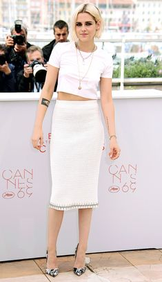 2016 Cannes: Kristen Stewart is wearing a white cropped t shirt with a white tweed pencil skirt both by Chanel. I love this look on her! The crop top and pencil skirt is a mix of casual and sophisticated! The black and white pumps add some edge!