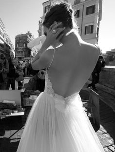 Backless, spaghetti strap, bow and tulle in A-line silhouette. Very cute and sexy at the same time
