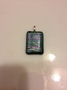 Green dichroic fused glass pendant on Etsy, $15.00