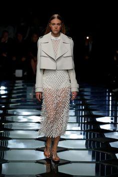Ticker tape dress and boxy leather jacket at Balenciaga SS15 PFW. More images here: http://www.dazeddigital.com/fashion/article/21935/1/balenciaga-ss15
