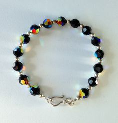 - Swarovski Jet AB faceted 8mm round and/or bicone crystals - brilliant refracted rainbow colors in any light - solid Sterling Silver .925 beads and clasp - all hand-crafted - sizes: 7.50, 7.75 and 8.