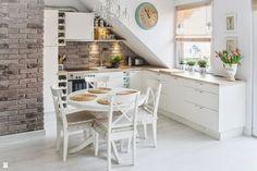 Bright attic with a Nordic interior design