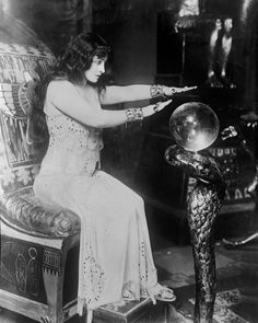 Conjuring and seeing into the Crystal Ball.  That is some Crystal Ball... worth a bloody fortune all by itself let alone the stand it sits on.  Wow!