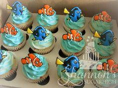 """Finding Dory"" theme cupcakes. Confetti cupcakes with bubblegum flavour buttercream. Aqua and white icing with royal icing Nemo and Dory toppers. Keyword: Disney."