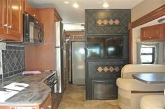 2016 New Thor Motor Coach Outlaw 37LS Class A in Colorado CO.Recreational Vehicle, rv, 2016 THOR MOTOR COACH Outlaw37LS, 2 Sofas in Garage A, Bug Screen Curtain in Garage, Electric Fireplace, Exterior- Cherry Fire, Interior- Metallic, Olympic Cherry Cabinetry,