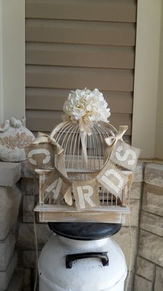 Add the burlap cards sign to dress up your birdcage.  Love it!