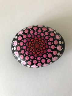 A personal favorite from my Etsy shop https://www.etsy.com/listing/522426005/mandala-stone-hand-painted-rock-dot