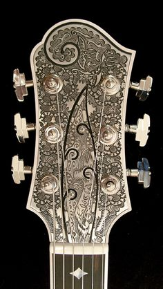 """2 of 2: Teye La Perla """"A"""". Check out the engraving work on the headstock."""