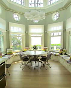 Love window seats Such drama with two story windows. I can imagine having morning tea/coffee with my honey