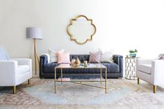 gold details and tufted sofa add glam to this laid back living room  Photography : Monica Wang Read More on SMP: http://www.stylemepretty.com/living/2016/10/14/this-bachelorette-has-the-winning-combo-for-a-stunning-living-room/
