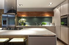 Back painted glass.  Contemporary Kitchen by Casey & Fox