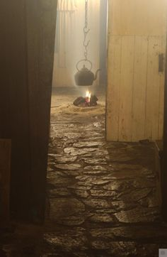 Interior view of Arnol Blackhouse showing the fireroom.  #Scotland #History #peopleatwork