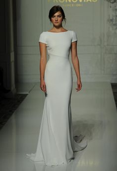 Pronovias short sleeve white sheath style wedding dress Fall 2016 | https://www.theknot.com/content/pronovias-wedding-dresses-bridal-fashion-week-fall-2016