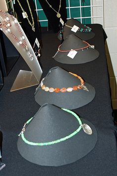 DIY cone necklace display. Can pack flat for transport. Would look so pretty in natural linen.