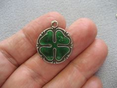 "German/Austrian 800 silver lucky shamrock charm (visible under the enamel: horseshoe, mushroom, and ""Viel Glück"")"