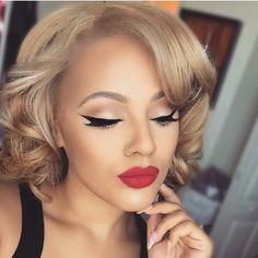 I like this makeup. The winged eye is awesome. I haven't had the chance to see how the boyfriend looks with the winged look yet, but maybe I will soon.