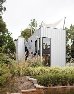 """The home's metal cladding is Pac-Clad, a material typically used for roofs. Tagged: Exterior, Cabin Building Type, House Building Type, and Metal Siding Material. Search """"dreams happen weekend"""" from Come Sail Away. Backyard Canopy, Diy Canopy, Canopy Outdoor, Canopy Tent, Ikea Canopy, Hotel Canopy, Canopy Curtains, Canopy Bedroom, Townhouse"""