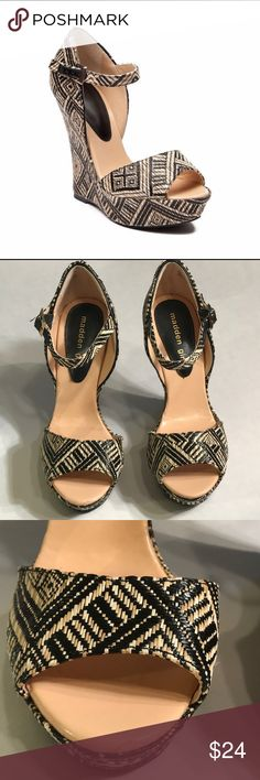 "Madden Girl Attitude Weave Tribal print wedges Madden Girl Attitude Weave Tribal print wedges. Black and tan weave material. Tribal, geo print. Platform wedges. Open toe, buckle sandals. Great condition. Bottom of shoes have some wear and minimal wear around edges at bottom of shoes. 1 ½"" platform, 6"" wedge. Size 8.5. Madden Girl Shoes Wedges"