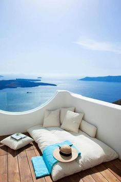 Santorini , Greece....... I can see us there cuddled up together reading our favorite books..... <3