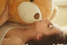 girl with teddy bear - sensual girl lying with teddy bear, toned image