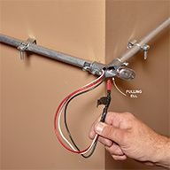 Running electrical conduit on the surface of a wall is an easy way to add wiring to a workshop, garage or basement or anywhere else there are no open stud cavities. And electrical metallic tubing (EMT) is a perfect choice. It's strong, cheap and easy to bend once you learn how. After the conduit and boxes are mounted, you push or pull wires into them, and connect the wires to the switches, outlets, lights or other devices you're installing. These tips will help you get the job done right.