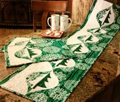 The Grand Fir Garland table runner and place mats pattern from Happy Stash Quilts appears in the 2016 Christmas issue of Quilters Newsletter Magazine.