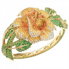 Tiffany diamond and gemstone flower bracelet with tsavorites, yellow and white diamonds, and spessertites in 18 karat gold - unique jewelry