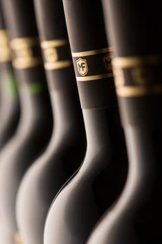 Vinhos Maufer on Behance - wine bottle necks: photography about wine