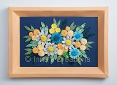 Quilled flowers in a beveled paper frame