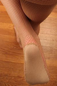 Showgirl fishnets with padded soles. These were once a staple. We're on the prowl for something similar - don't worry.