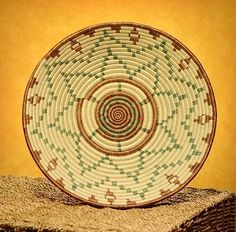 """Rwandan Handcrafted 12"""" Sisal and Sweet Grass Basket. $39.99 via https://rwandabasketsr.3dcartstores.com/ This design, inspired by the sun-burst symbol on the Rwandan flag, is close to the hearts of the weavers we partner with. With each basket the women sell, their hope for a brighter future becomes more of a reality."""