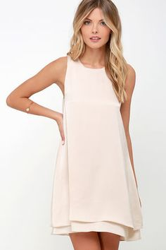 There's no reason to hide in the shadows, bask in the light of the night sky with the Moonlit Masquerade Beige Swing Dress! Lightweight beige satin fabric shapes a sleeveless bodice with a swing silhouette. Rounded neckline fastens at back with hook closure above a keyhole, while a tiered hem adds a fluttering finish.