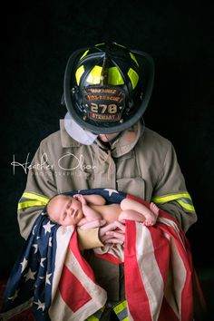 Firefighter Newborn - our precious little one with his Daddy. So very, very special.