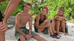 Spencer, Kelley, and Abi-Maria listen to another castaway on the beach.