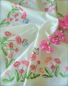 Check out this item in my Etsy shop https://www.etsy.com/uk/listing/543195125/vintage-hand-embroidered-pink-daisy
