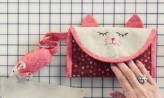 Join us for an adorable sewing project, the Kitty Caddy Clutch! We have a video tutorial to help you with the project and a quilt along!