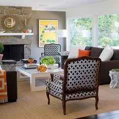 We have a dark brown sofa, cream love seat/ottoman, and multi colored green/blue/cream armchair.