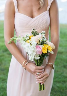 Pale pink bridesmaid dress + a summer bouquet: http://www.stylemepretty.com/new-york-weddings/oyster-bay-new-york/2015/12/21/classic-summer-waterfront-wedding/ | Photography: Ryon:Lockhart - http://www.ryonlockhart.com/
