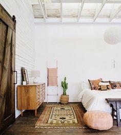 bedroom - wooden floor, antique Persian rug, white bedding
