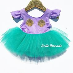 Gorgeous Ballerina Tutu Leotard Dress with lace sleeves. The leotard has a…