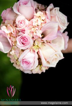 Stunning close up of Bridesmaid bouquets. Excellent mix of Hydrangeas, calla lilies and pink roses. Floral Designs by McNamara Florist. All Rights Reserved.