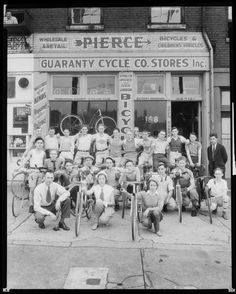 Group posed with bicycles outside of the Guaranty Cycle Company store at 108 North Street (later renamed Tucker Boulevard). Photograph taken by Harold Sneckner for Sievers Studio in Sievers Studio Collection, Missouri History Museum. Old Bicycle, Bicycle Shop, Old Bikes, Velo Retro, Group Poses, Vintage Cycles, Bike Art, History Museum, Historical Society