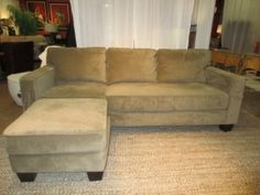 "| Item #: 48244  Sofa with ottoman in an olive color. This fabric is oh-so-smooth! Feels great to the touch. The ottoman can be used anywhere in the room or be placed against the left cushion to create a chaise. Measures 90""long x 37""deep"
