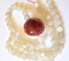 milky white moonstone  fire agate stacking choker. by WildVeil
