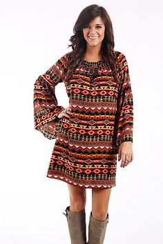 "Aztec Bell Sleeve Dress, Rust $42.00 Talk about eye catching! The vibrant colors in this aztec print shift dress are too fun! The raglan sleeves end in a big bell which is very on trend this season, and the elastic neckline can also be worn off the shoulder.   Fits true to size. Miranda is wearing a small.   From shoulder to hem:  Small - 33""  Medium - 33.5""  Large - 34"