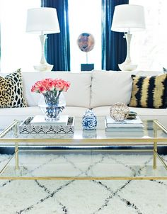 LMC Interiors | photo Laurie Perez / brass coffee table; blue velvet drapes
