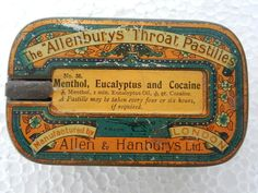 Tin for throat pastille containing cocaine.