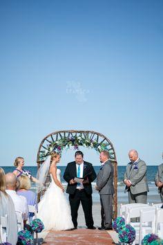 Beach Wedding | True Era Photography  #beach #wedding #bride #bouquet #portrait #weddingdress #updo #boardwalk #oneocean #weddingphotography #weddingphotographer #jacksonville #jacksonville #florida #bouquet #arch #floral #sunny #bride #groom #ceremony #vows