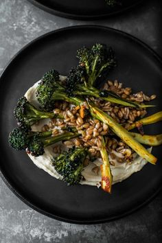 An easy grain bowl that features chili roasted broccoli tossed with farro and served with hummus and an optional egg. Perfect for lunch, dinner, or breakfast. #grainbowl #hummus #roastedvegetable