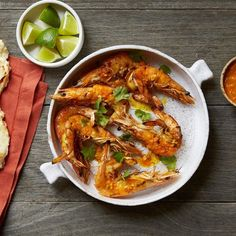 Grilled Butterflied Prawns with Sriracha-Lemongrass Butter:  These shrimp are so big and sweet you'd never know they weren't lobster. Hinged grill baskets make turning them super easy.